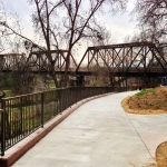 The west end of the Putah Creek Walk and Nature Trail. It stops under the bridge behind the Community Center.